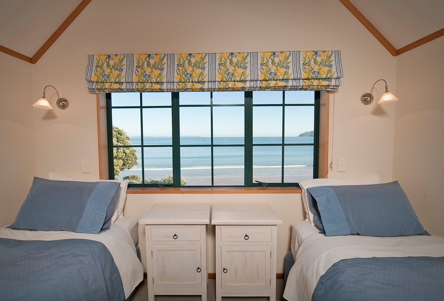 upstairs bedroom with twin beds at beach lodge coopers beach
